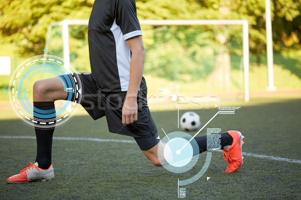 soccer player stretching leg on field football Stock photo © dolgachov
