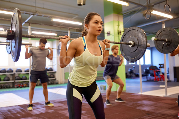 group of people training with barbells in gym Stock photo © dolgachov