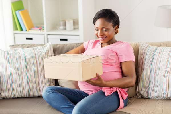 happy pregnant woman with parcel box at home Stock photo © dolgachov
