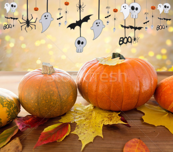 pumpkins with autumn leaves and halloween garland Stock photo © dolgachov