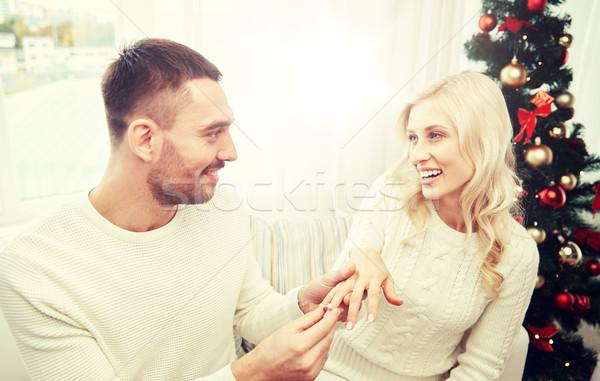 Férfi eljegyzési gyűrű nő karácsony szeretet pár Stock fotó © dolgachov