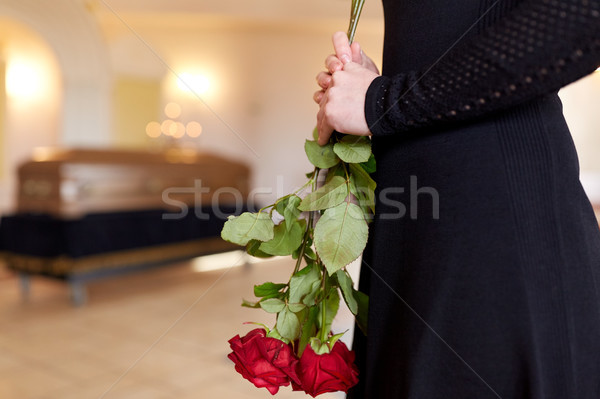 close up of woman with roses and coffin at funeral Stock photo © dolgachov