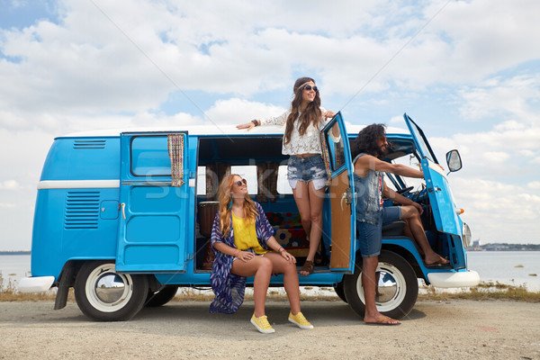 smiling happy young hippie friends at minivan car Stock photo © dolgachov