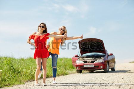 hippie friends near minivan car showing peace sign Stock photo © dolgachov