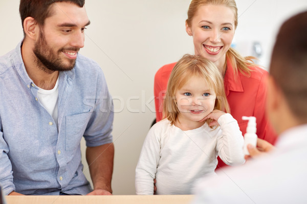 happy family with daughter and doctor at clinic Stock photo © dolgachov