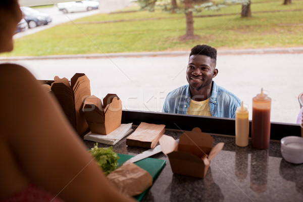 african american man ordering wok at food truck Stock photo © dolgachov