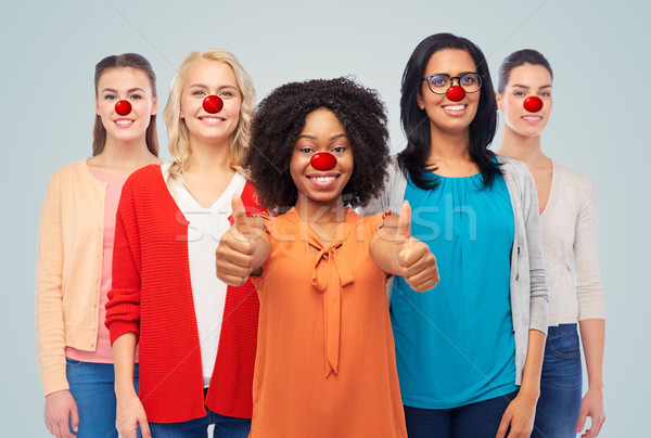 group of women showing thumbs up at red nose day Stock photo © dolgachov