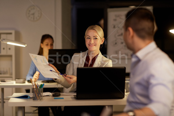 coworkers with papers working late at night office Stock photo © dolgachov