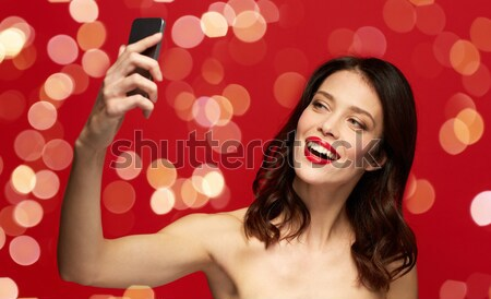 beautiful woman with red lipstick holding diamond Stock photo © dolgachov