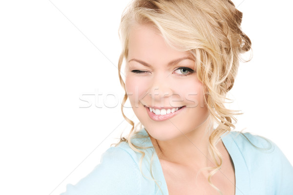 winking woman Stock photo © dolgachov
