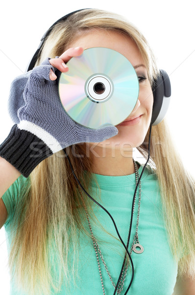 urban teenage girl in headphones holding cd Stock photo © dolgachov