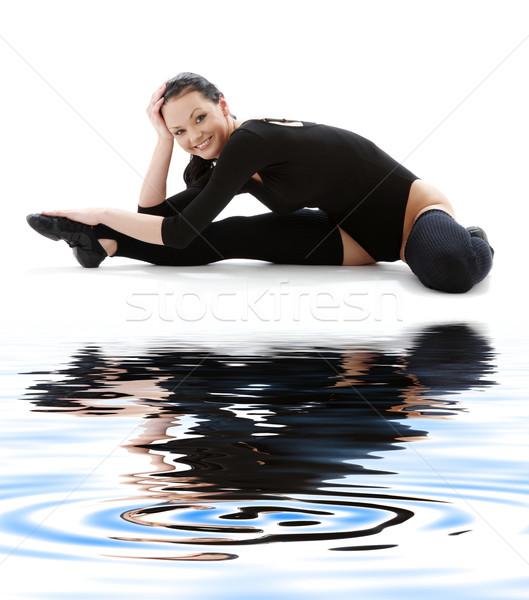 fitness black leotard on white sand #4 Stock photo © dolgachov