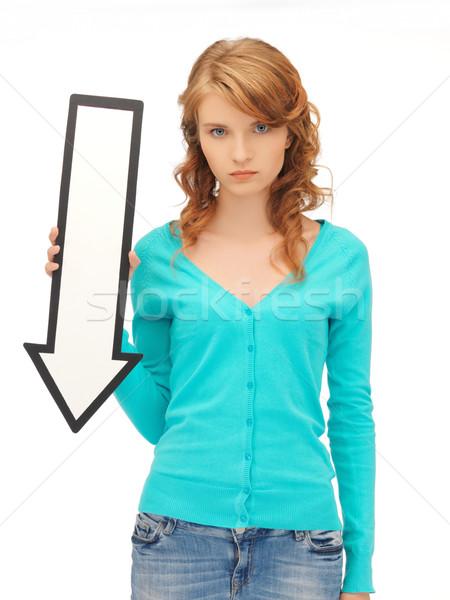 teenage girl with direction arrow sign Stock photo © dolgachov