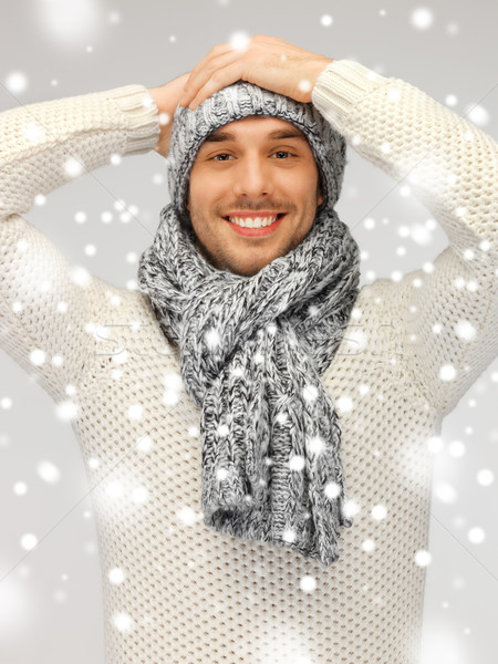 Jóképű férfi meleg pulóver kalap sál kép Stock fotó © dolgachov