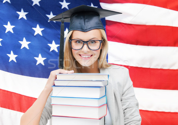 student in graduation cap Stock photo © dolgachov