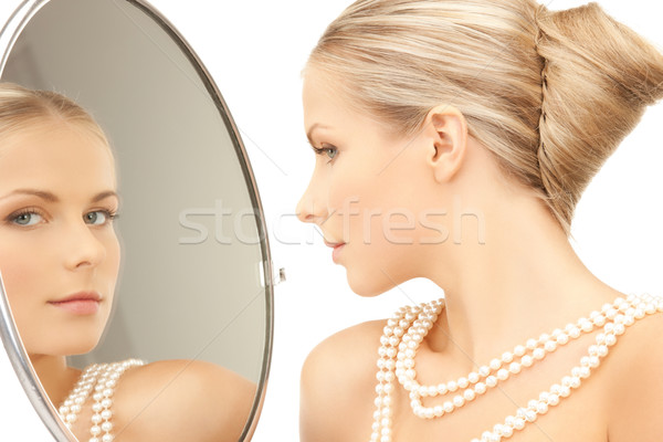 woman with necklace from pearls Stock photo © dolgachov