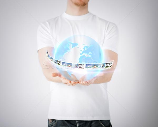 man with virtual globe and news Stock photo © dolgachov