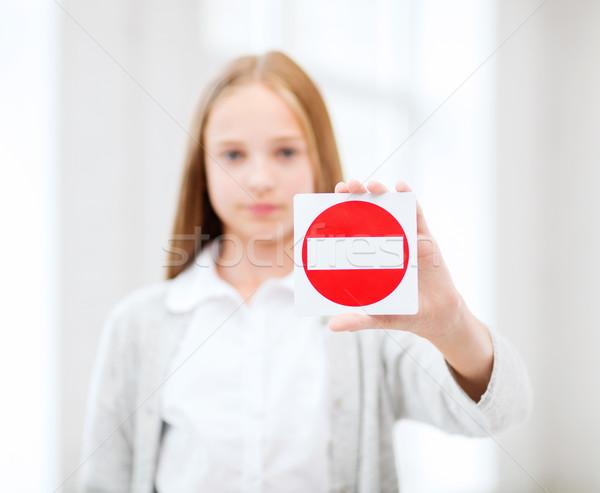 girl showing no entry sign Stock photo © dolgachov