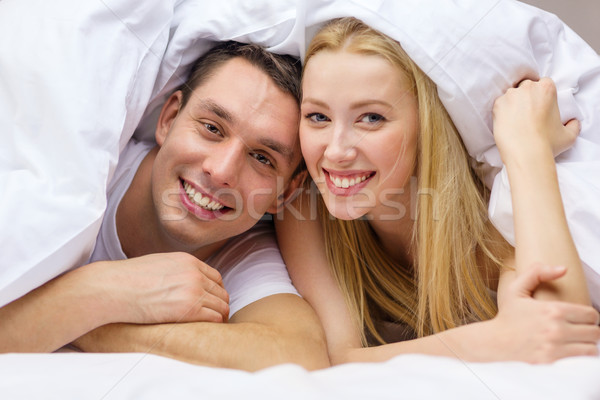 happy couple sleeping in bed Stock photo © dolgachov