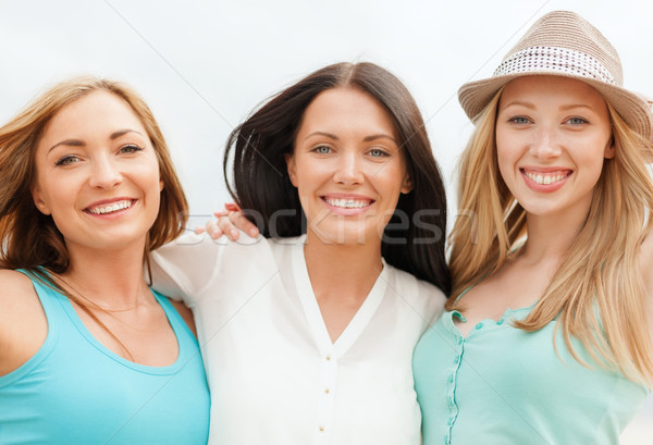 group of smiling girls chilling on the beach Stock photo © dolgachov