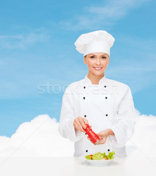 smiling female chef with preparing salad Stock photo © dolgachov