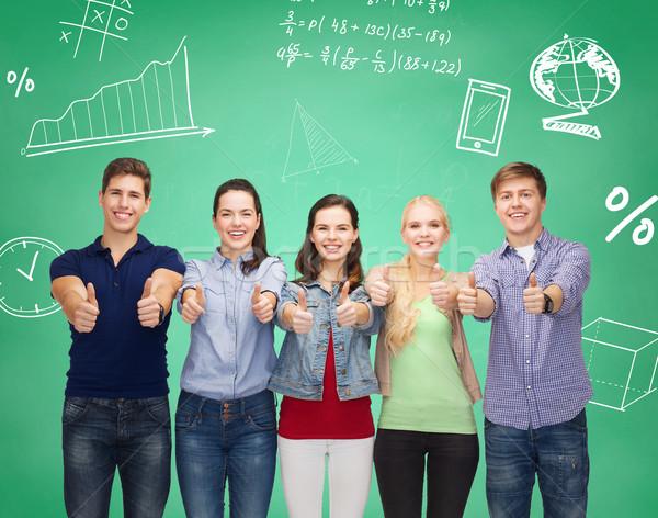 Csoport mosolyog diákok mutat remek oktatás Stock fotó © dolgachov