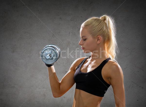 женщину стали гантели фитнес Сток-фото © dolgachov