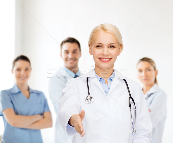 Stock photo: smiling female doctor with stethoscope
