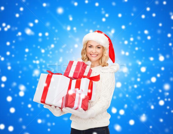笑みを浮かべて 若い女性 サンタクロース ヘルパー 帽子 贈り物 ストックフォト © dolgachov