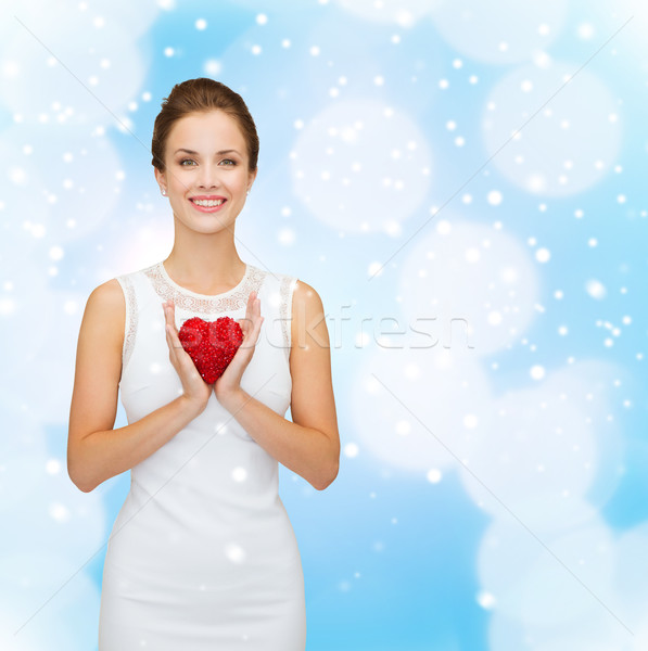 4958987_stock-photo-smiling-woman-in-white-dress-with-red-heart.jpg