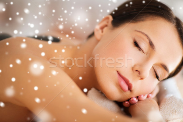 Stock photo: woman in spa salon with hot stones