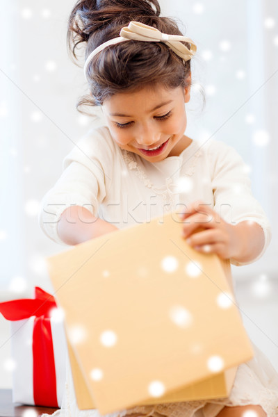smiling little girl with gift box Stock photo © dolgachov