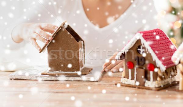 Stockfoto: Vrouw · peperkoek · huizen · koken