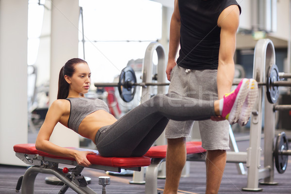 woman with trainer doing abdominal exercise in gym Stock photo © dolgachov