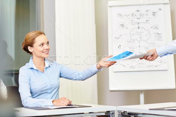 Empresária documentos alguém escritório pessoas de negócios Foto stock © dolgachov