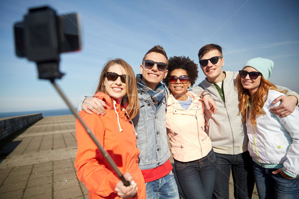 smiling friends taking selfie with smartphone Stock photo © dolgachov