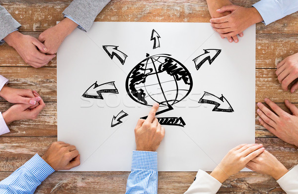 close up of business team with globe drawing Stock photo © dolgachov