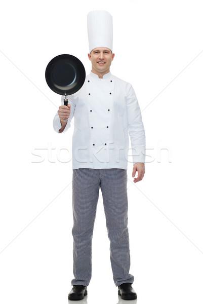 Heureux Homme chef Cook poêle Photo stock © dolgachov