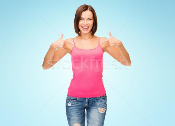 Femme rose réservoir haut pointant doigts Photo stock © dolgachov