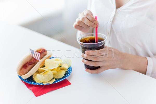 Kadın içme coca cola amerikan gün Stok fotoğraf © dolgachov