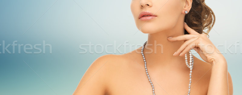 woman with pearl earrings and necklace Stock photo © dolgachov