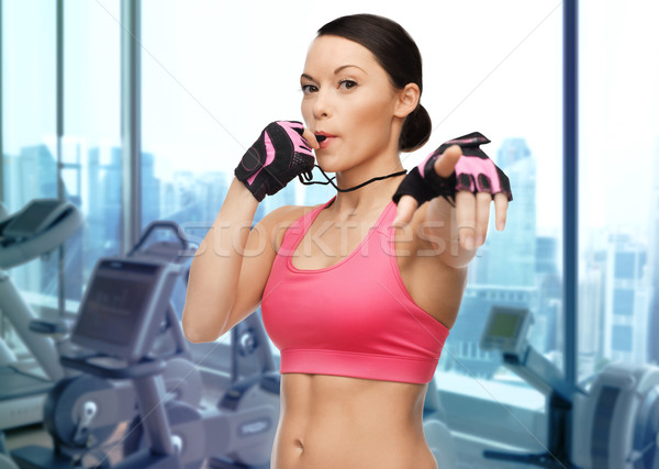asian woman coach blowing whistle over gym Stock photo © dolgachov
