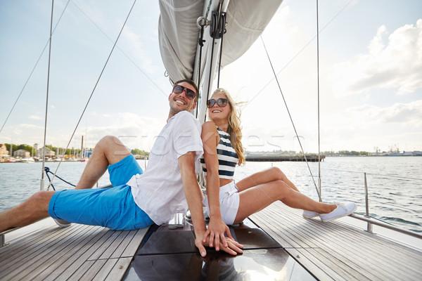 smiling couple sitting on yacht deck Stock photo © dolgachov