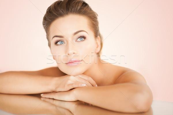 woman with mirror Stock photo © dolgachov