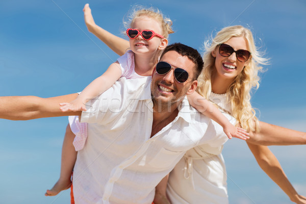 happy family having fun over blue sky background Stock photo © dolgachov