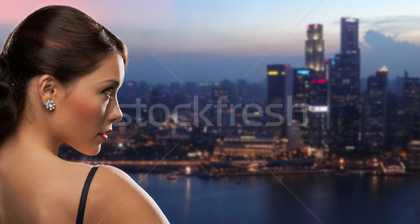 woman with diamond earring over night city Stock photo © dolgachov