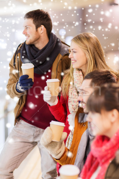 happy friends with coffee cups on skating rink Stock photo © dolgachov