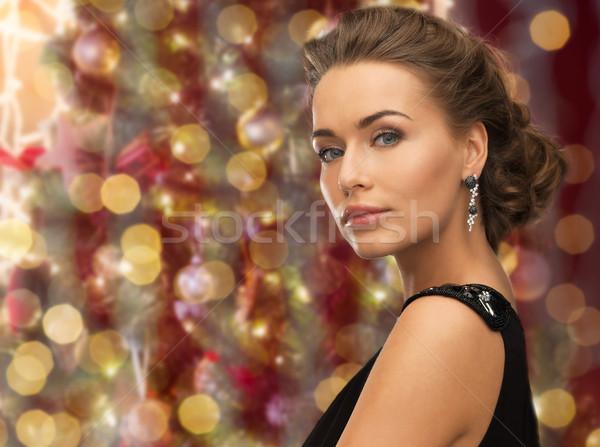 Bela mulher brincos luzes pessoas férias Foto stock © dolgachov
