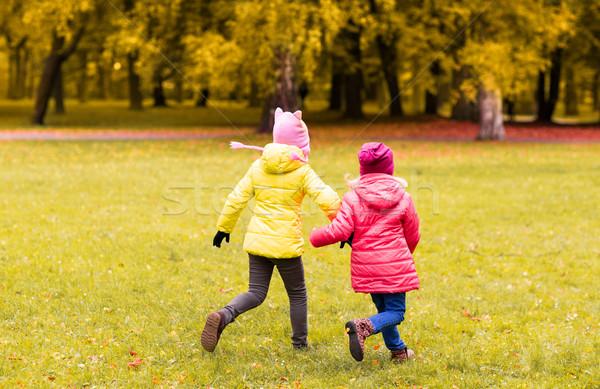happy little girls running outdoors Stock photo © dolgachov