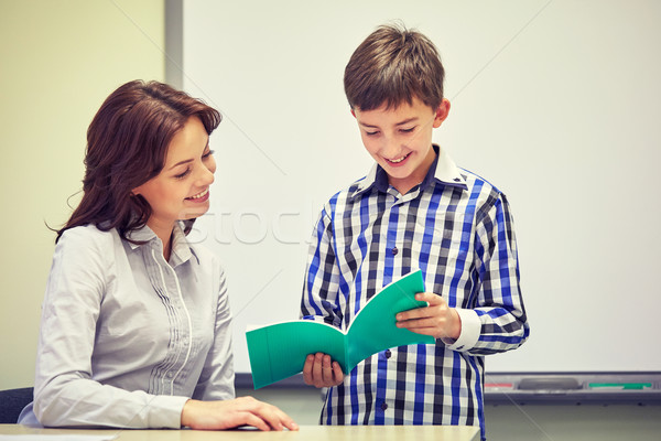Schooljongen notebook leraar klas onderwijs Stockfoto © dolgachov